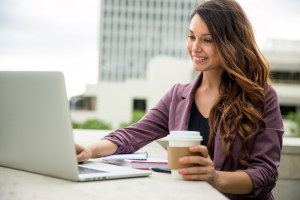Woman drinking coffee on Facebook