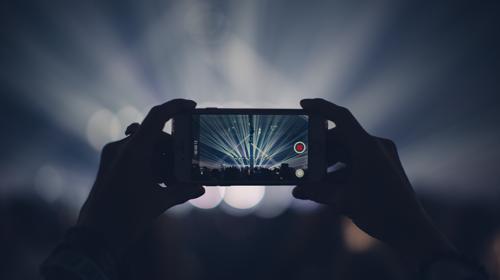 Influencer capturing event stage